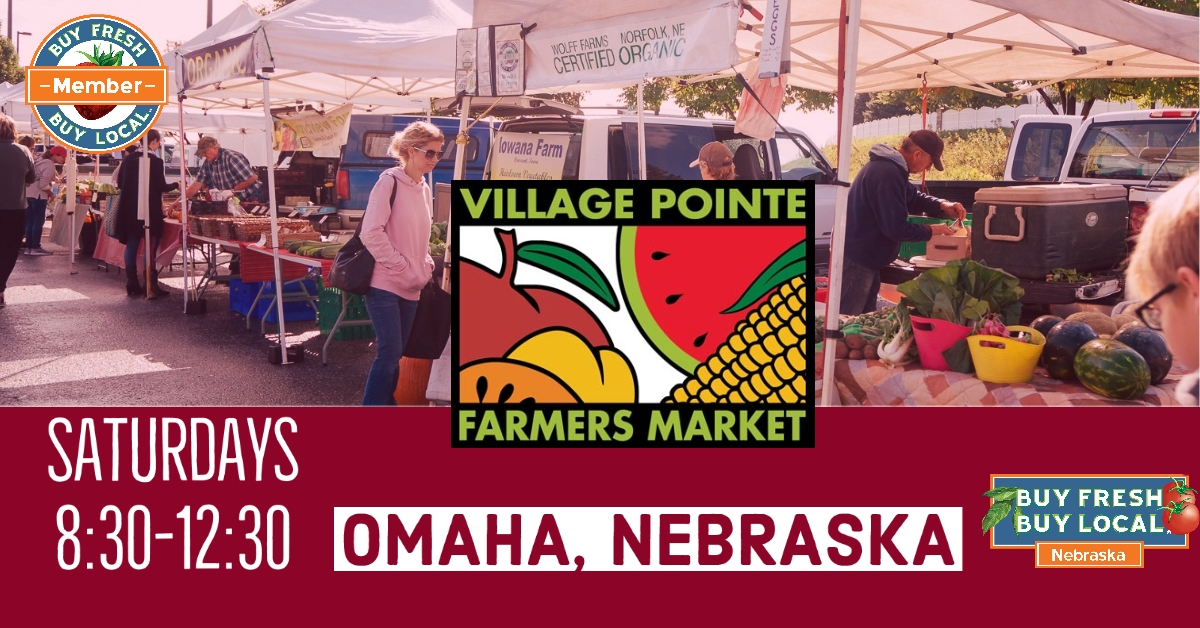 Village pointe farmers' market scene of vendors and customers.